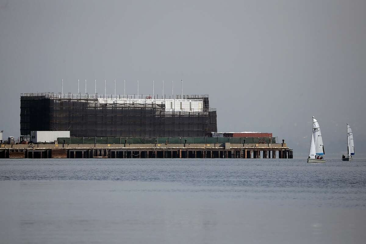 The barge under construction is docked at a pier on Treasure Island on October 30, 2013 in San Francisco.