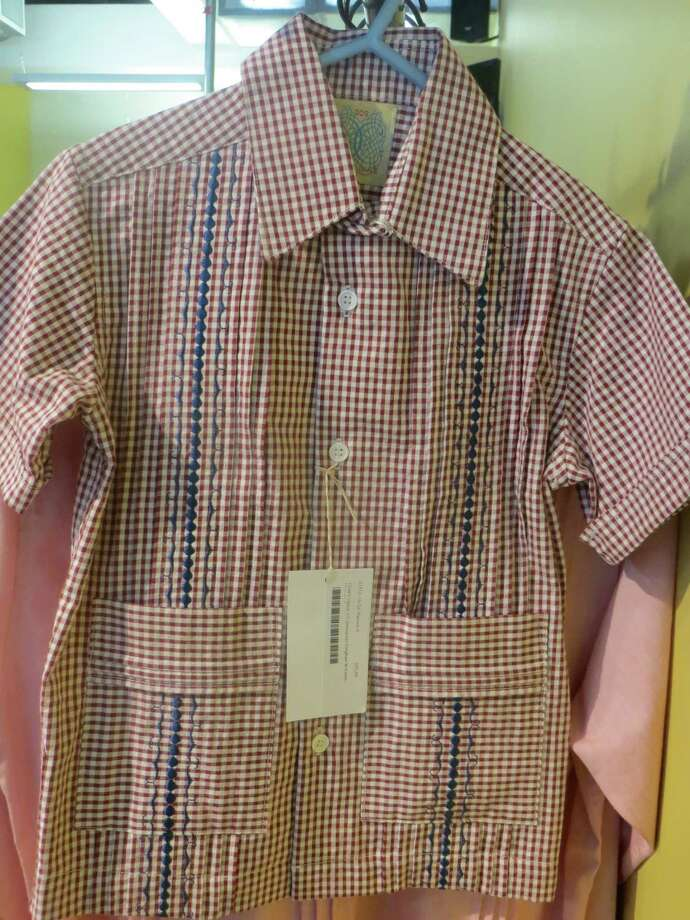 303 Pearl Parkway, Suite 102: Adorable boy's gingham seersucker shirt with embroidery, $65, at Dos Carolinas. Photo: Jennifer Rodriguez