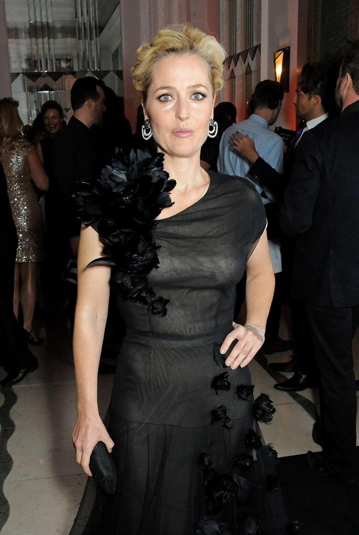 Gillian Anderson arrives at the Harper's Bazaar Women of the Year awards at Claridge's Hotel on November 5, 2013 in London, England. (Photo by David M. Benett/Getty Images)
