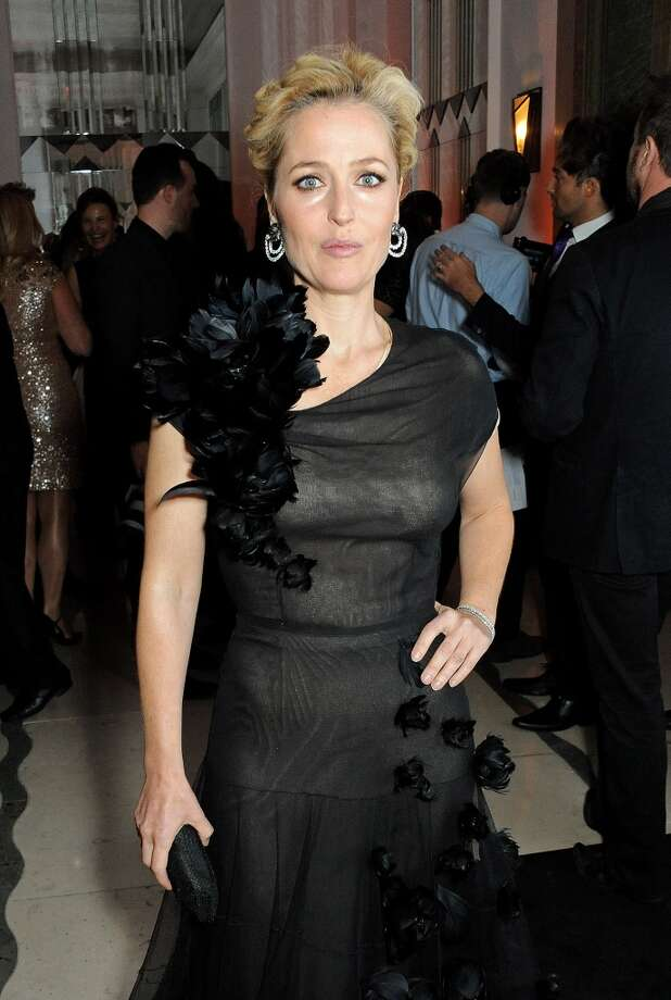Gillian Anderson arrives at the Harper's Bazaar Women of the Year awards at Claridge's Hotel on November 5, 2013 in London, England.  (Photo by David M. Benett/Getty Images) Photo: David M. Benett, Getty Images