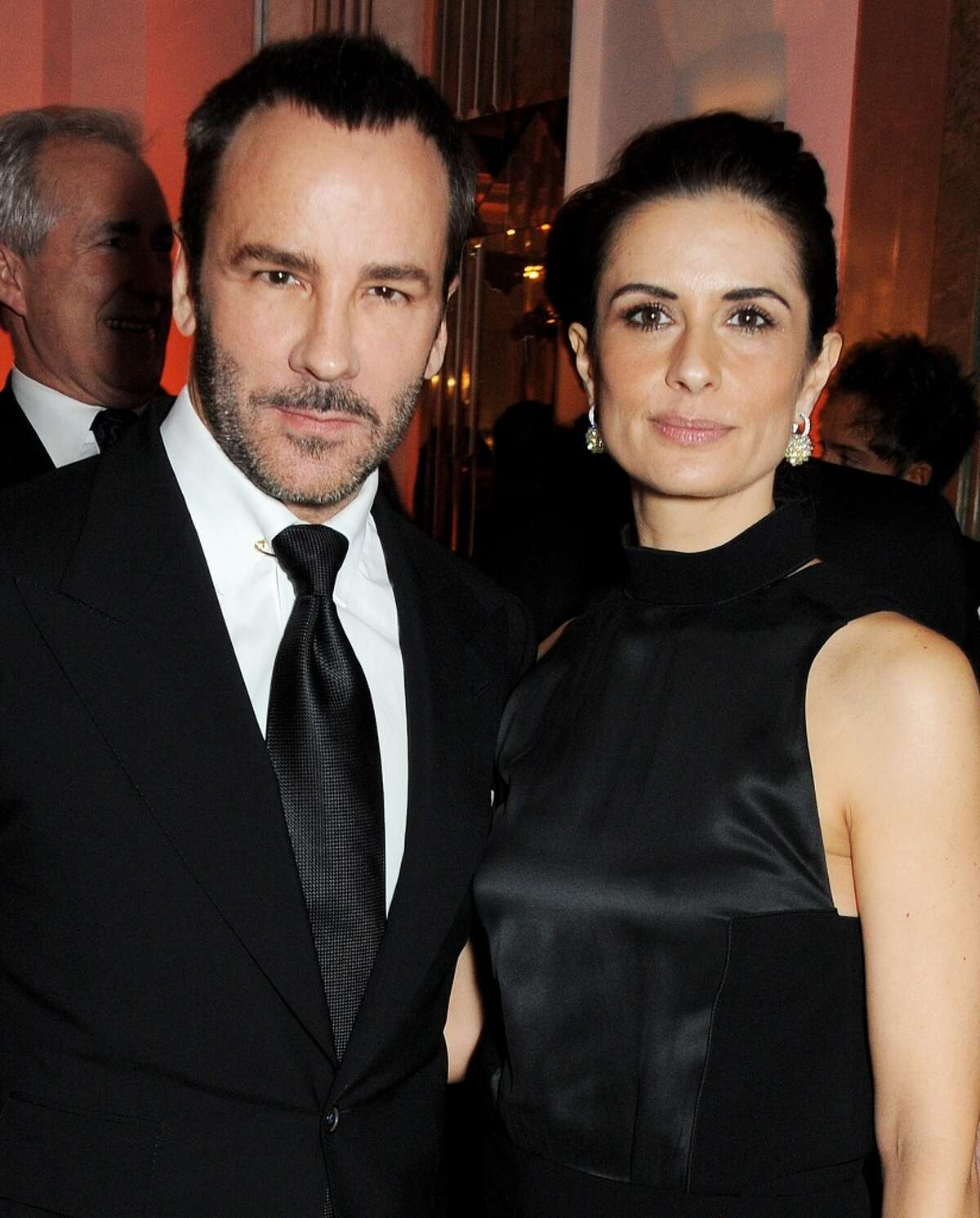 Tom Ford (L) and Livia Firth arrive at the Harper's Bazaar Women of the Year awards at Claridge's Hotel on November 5, 2013 in London, England. (Photo by David M. Benett/Getty Images)