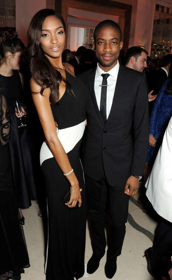 Jourdan Dunn (L) and guest arrive at the Harper's Bazaar Women of the Year awards at Claridge's Hotel on November 5, 2013 in London, England.  (Photo by David M. Benett/Getty Images) Photo: David M. Benett, Getty Images