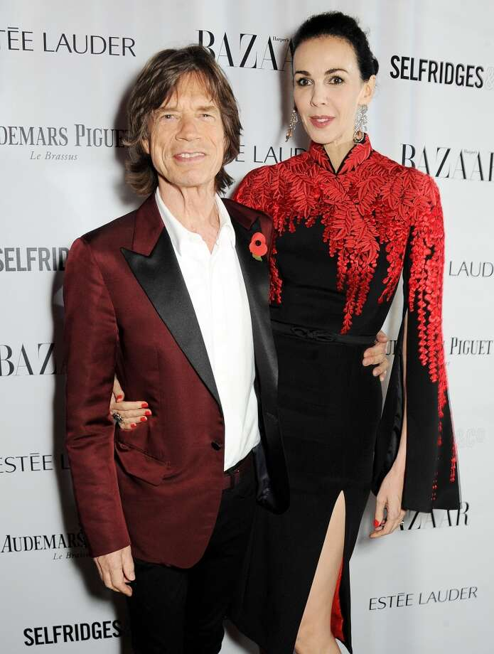 Sir Mick Jagger (L) and L'Wren Scott arrive at the Harper's Bazaar Women of the Year awards at Claridge's Hotel on November 5, 2013 in London, England.  (Photo by David M. Benett/Getty Images) Photo: David M. Benett, Getty Images