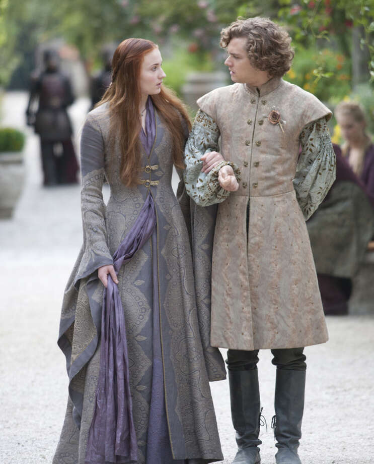 "Sophie Turner as Sansa Stark and Finn Jones as Loras Tyrell walk together during shooting of ""Game of Thrones."">>Keep clicking to see ten things we learned during last year's Comicpalooza. Photo: Picasa"
