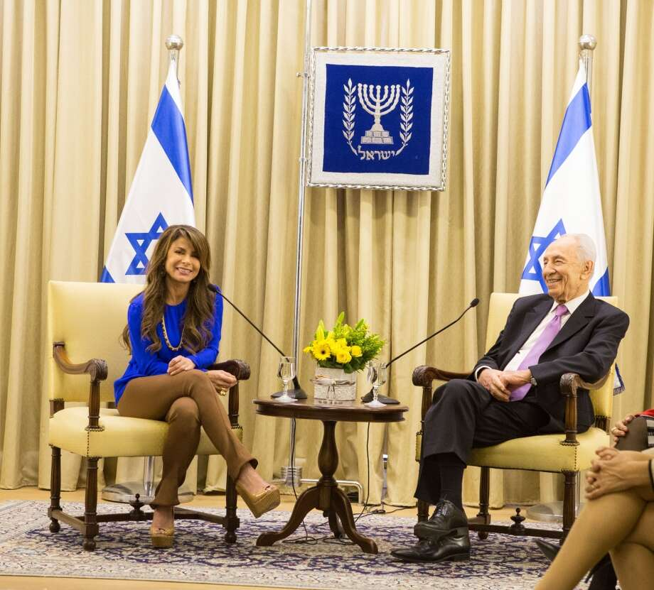 Paula Abdul visits with the President of Israel Shimon Peres at his estate on October 29, 2013 in Jerusalem, Israel. Photo: Tiffany Rose, WireImage