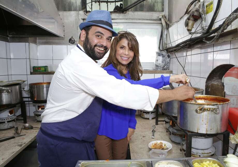 Chef Mr. Uri Navon and Paula Abdul visit  the historical Machane Yehuda Market on October 29, 2013 in Jerusalem, Israel. Photo: Tiffany Rose, WireImage
