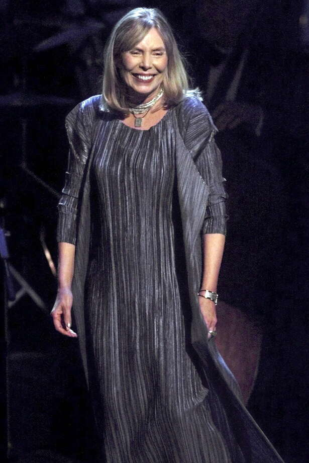 Singer-songwriter Joni Mitchell smiles as she takes the stage to sing 'Both Sides Now,' during the taping of Turner Network Television's 'All-Star Tribute to Joni Mitchell,' Thursday, April 6, 2000, at Hammerstein Ballroom in New York. (AP Photo/Suzanne Plunkett) Photo: SUZANNE PLUNKETT / AP