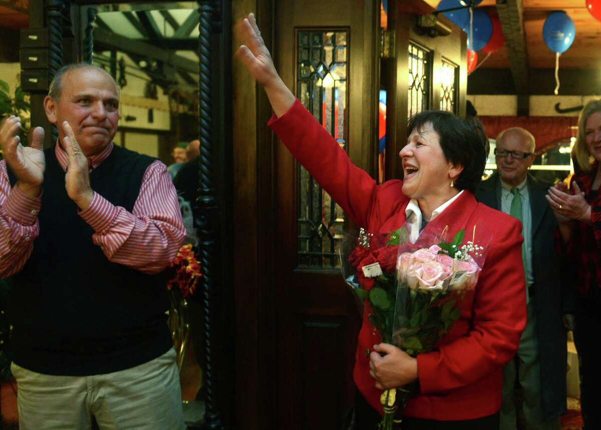 Mayoral candidate Anita Dugatto greets supporters at Grassy Hill Lodge after winning the election Tuesday, Nov. 5, 2013 in Derby, Conn.