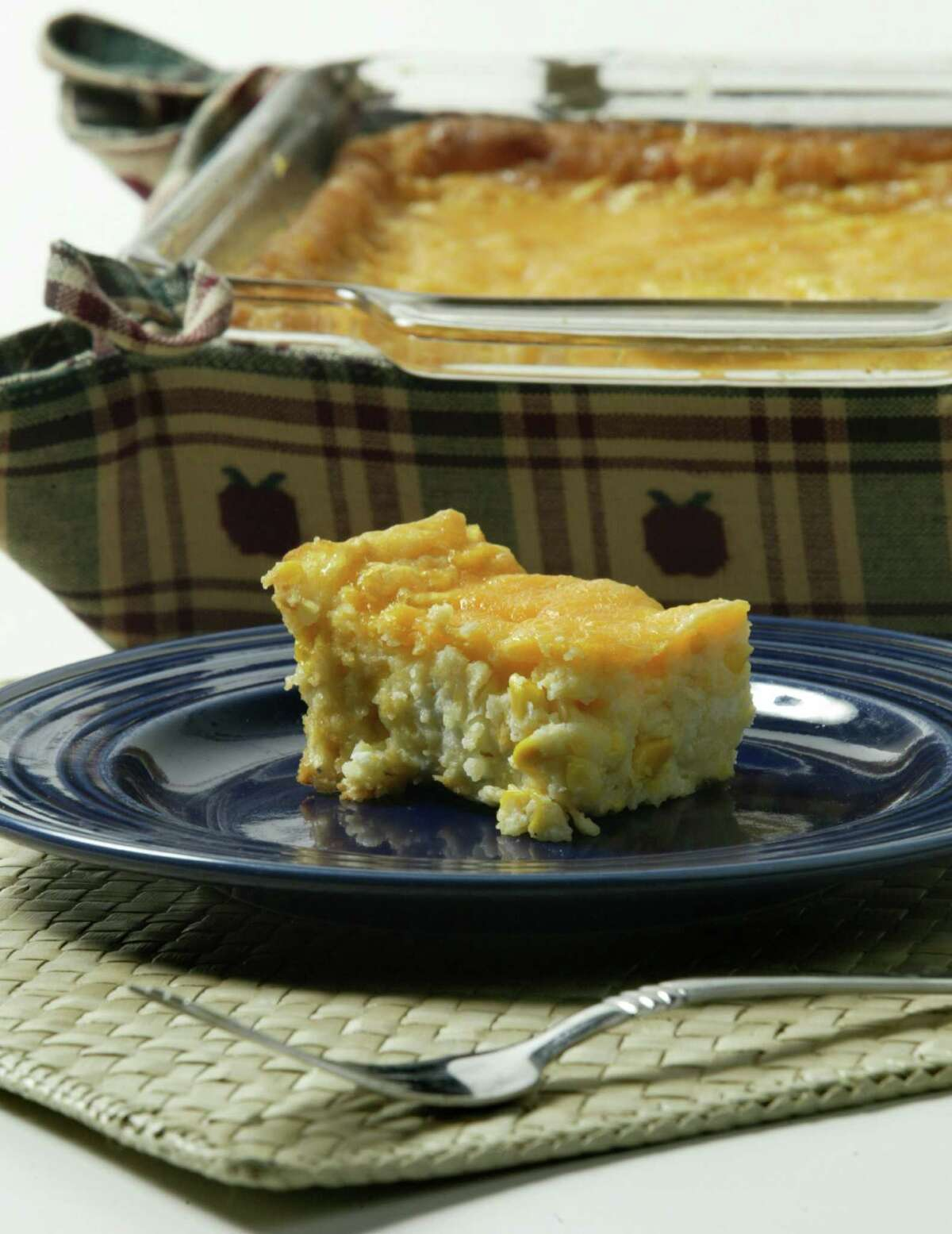 Corn Casserole photographed for Houston Chronicle Our Favorite Recipe feature. Shot Thursday afternoon October 9, 2003. -- (photograph by D. Fahleson, Houston Chronicle Staff Photojournalist) HOUCHRON CAPTION (11/05/2003): Cream cheese gives body to this baked Corn Casserole.