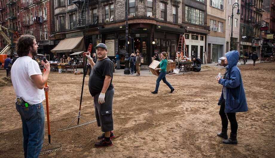 "Workers are seen on set for a television show currently being filmed on November 6, 2013 in the Lower East Side neighborhood of the Manhattan borough of New York City. According to a worker on set, the show is a TV mini-series currently titled ""The Knick,"" is directed by Steven Sodenburgh and stars Clive Owen. Photo: Andrew Burton, Getty Images"