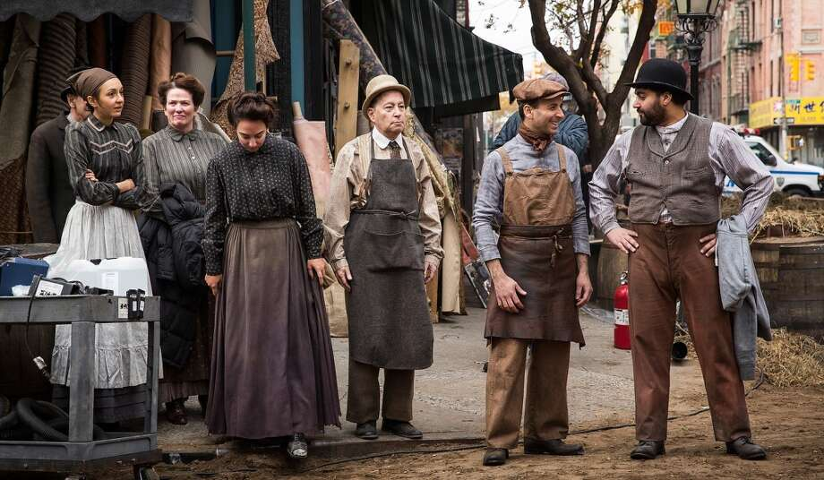 """Actors and actresses wait for further direction while on the set of a television show currently being filmed on November 6, 2013 in the Lower East Side neighborhood of the Manhattan borough of New York City. According to a worker on set, the show is a TV mini-series currently titled """"The Knick,"""" is directed by Steven Sodenburgh and stars Clive Owen. Photo: Andrew Burton, Getty Images"""