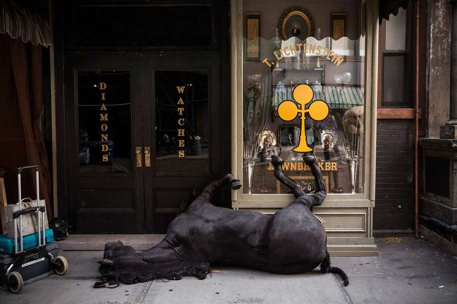 "A fake dead horse is seen on set for a television show currently being filmed on November 6, 2013 in the Lower East Side neighborhood of the Manhattan borough of New York City. According to a worker on set, the show is a TV mini-series currently titled ""The Knick,"" is directed by Steven Sodenburgh and stars Clive Owen. Photo: Andrew Burton, Getty Images"