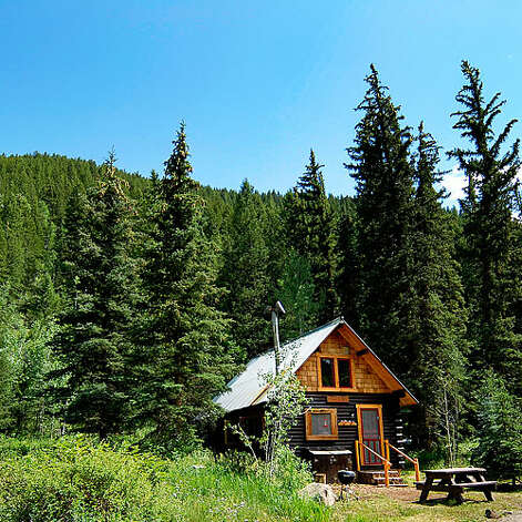 Pioneer Guest Cabins, Crested Butte, CO  Why it's cozy: Buckets of chopped wood, riverside hammocks, and kitchenettes.  What's out the door: Hiking, mountain biking, snowshoeing, and cross-country skiing along creeks and through meadows ringed by Douglas fir.  Who will love it: Outdoorsy types who prefer fall leaves and fresh snow to Frette sheets.  8 two- and three-bedroom cabins; $$; pioneerguestcabins.com    Photo: Sunset.com