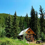 Pioneer Guest Cabins, Crested Butte, CO  Why it's cozy: Buckets of chopped wood, riverside hammocks, and kitchenettes.  What's out the door: Hiking, mountain biking, snowshoeing, and cross-country skiing along creeks and through meadows ringed by Douglas fir.  Who will love it: Outdoorsy types who prefer fall leaves and fresh snow to Frette sheets.  8 two- and three-bedroom cabins; $$; pioneerguestcabins.com