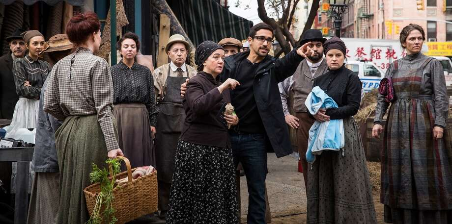 "Actors and actresses receive direction while on the set of a television show currently being filmed on November 6, 2013 in the Lower East Side neighborhood of the Manhattan borough of New York City. According to a worker on set, the show is a TV mini-series currently titled ""The Knick,"" is directed by Steven Sodenburgh and stars Clive Owen. Photo: Andrew Burton, Getty Images"