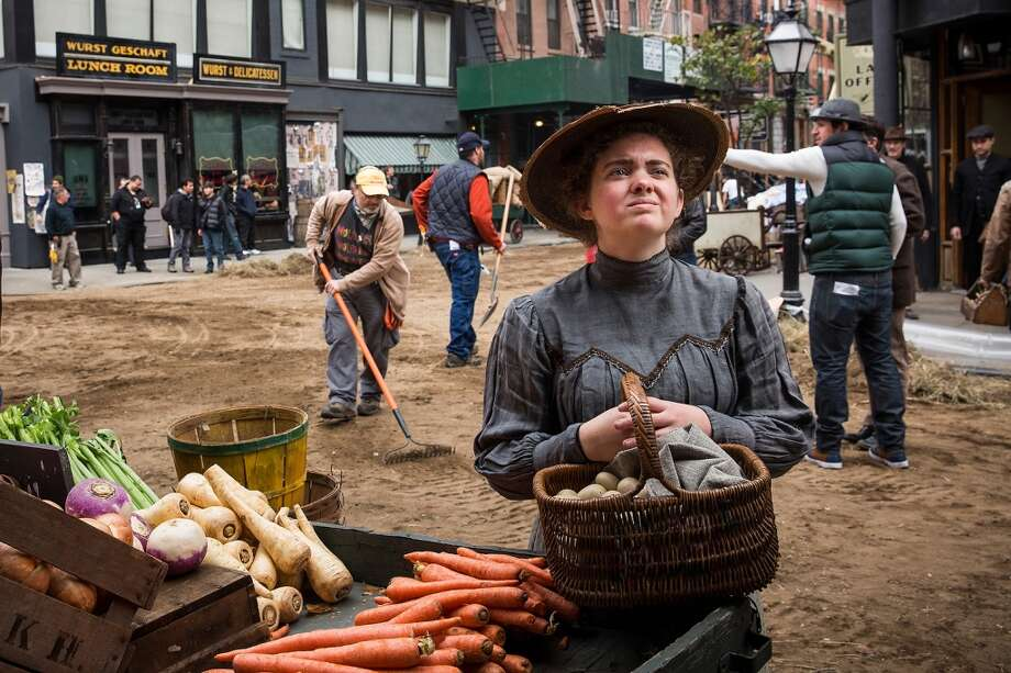 "An actress stands on the set of a television show currently being filmed on November 6, 2013 in the Lower East Side neighborhood of the Manhattan borough of New York City. According to a worker on set, the show is a TV mini-series currently titled ""The Knick,"" is directed by Steven Sodenburgh and stars Clive Owen. Photo: Andrew Burton, Getty Images"