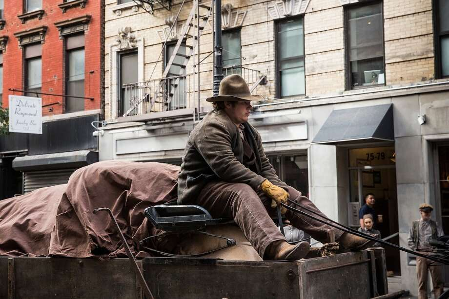 """An actor rides a top a horse-drawn cart on a set for a television show currently being filmed on November 6, 2013 in the Lower East Side neighborhood of the Manhattan borough of New York City. According to a worker on set, the show is a TV mini-series currently titled """"The Knick,"""" is directed by Steven Sodenburgh and stars Clive Owen. Photo: Andrew Burton, Getty Images"""