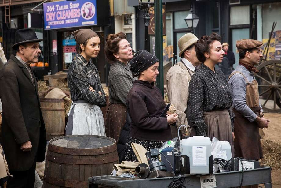 "Actors and actresses wait for further direction while on the set of a television show currently being filmed on November 6, 2013 in the Lower East Side neighborhood of the Manhattan borough of New York City. According to a worker on set, the show is a TV mini-series currently titled ""The Knick,"" is directed by Steven Sodenburgh and stars Clive Owen. Photo: Andrew Burton, Getty Images"