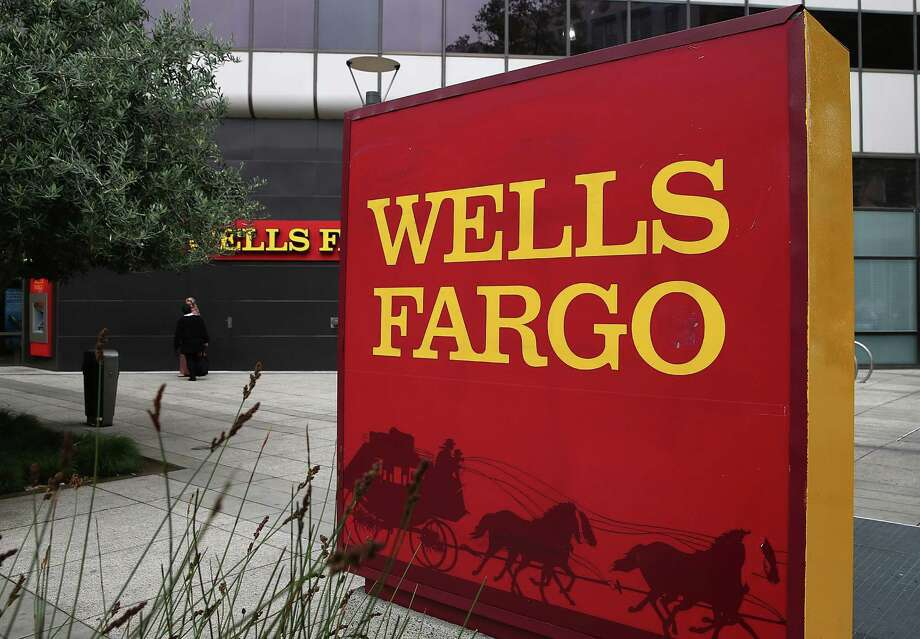 OAKLAND, CA - OCTOBER 11:  A sign is posted in front of a Wells Fargo bank on October 11, 2013 in Oakland, California. Wells Fargo reported a 13 percent increase in third-quarter profits with a net income of $5.6 billion, or 99 cents a share compared to $4.9 billion, or 88 cents a share one year ago.  (Photo by Justin Sullivan/Getty Images) Photo: Justin Sullivan / Getty Images / 2013 Getty Images