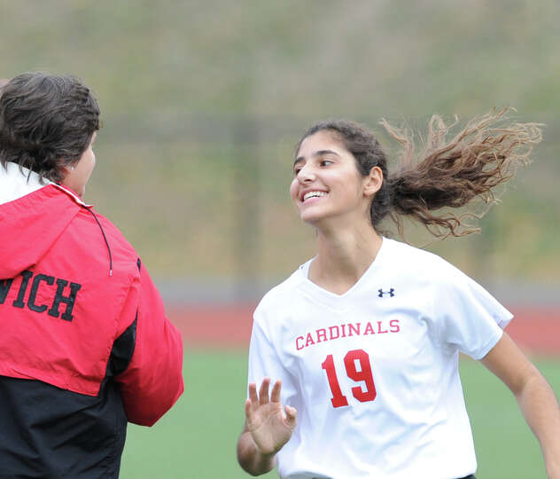 Tania Iskandar (# 19) of Greenwich is introduced during the Class L field hockey playoff between Gre