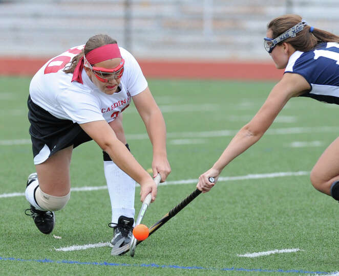 At left, Sarah Cicchetti (# 30) of Greenwich goes for the ball against Meg Fay (# 11) of Staples dur