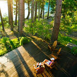 The Lodge at Suttle Lake, Sisters, OR  Why it's cozy: Rustic knotty pine meets wrought-iron chandelier, 35 miles northwest of Bend. Stone fireplaces, private decks, wooden rocking chairs.  What's out the door: The namesake 1 1⁄2-mile-long lake. Gliding or schussing at Hoodoo Ski Area, 8 1⁄2 miles west. Snowmobiling, snowshoeing, or lounging in the on-site spa.  Who will love it: Wedding parties, friends on a getaway.  6 rustic cabins (sleep 6) with shared bathrooms, $; 4 luxury waterfront cabins (sleep 4), $$$$; thelodgeatsuttlelake.com  Read more: 12 cozy winter lodges