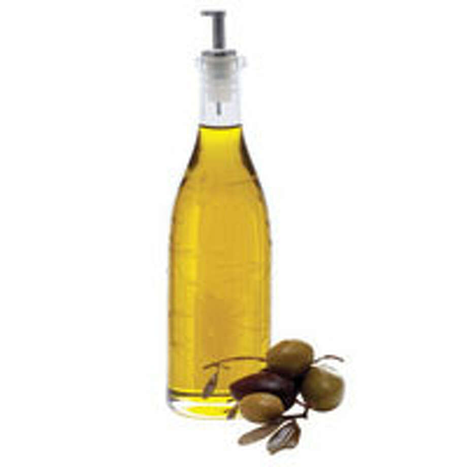 8. Olive Oil Fight off middle-age pounds with extra virgin olive oil. A monounsaturated fat, it'll help you burn calories. In an Australian study, 12 postmenopausal women (ages 57 to 73) were given a breakfast cereal dressed either with a mixture of cream and skim milk or half an ounce of olive oil and skim milk. The women who ate the oil-laced muesli boosted their metabolism. Don't want to add olive oil to your oatmeal? That's OK — it works just as well in salad dressings, as a bread dip, or for sautéing.Reprinted with Permission of Hearst Communications, Inc. Originally Published: 15 Foods to Help You Lose Weight Photo: Philip Friedman
