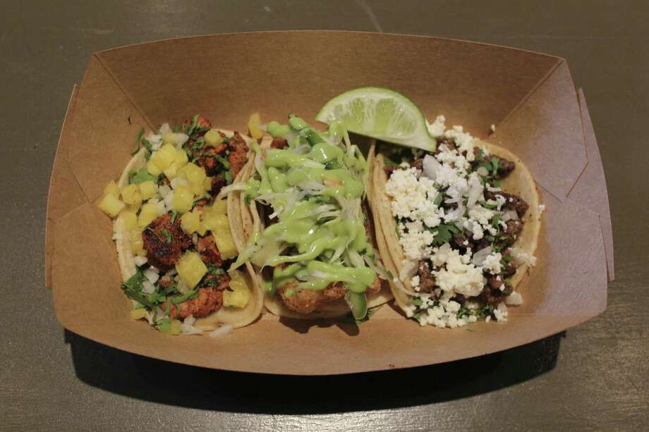The taco trio at Taps y Tapas is served with one each (from left) al pastor, fish and carne asada.