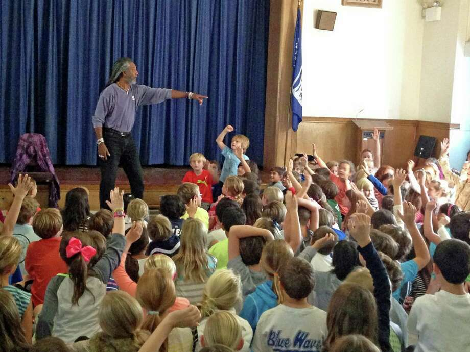 Storyteller Len Cabral engages his audience at Royle Elementary School in Darien with traditional African, Cape Verdean and Caribbean folktales. Photo: Contributed Photo, Contributed / Darien News