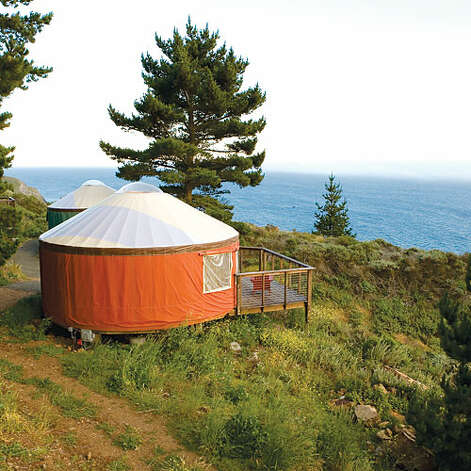 Treebones Resort, Big Sur, CA  Why it's cozy: Yurts with plush, queen-size beds piled with cozy comforters and colorful quilts, skylights for stargazing, and decks for spotting whales.  What's out the door: Big Sur. Period.  Who will love it: Young couples who want the romance of Big Sur—without the typical price tag that goes with it.  16 yurts (sleep 2); $$; treebonesresort.com   Photo: Sunset.com