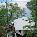 """Rockwater Secret Cove Resort, Halfmoon Bay, B.C.  Why it's cozy: Wooden walkways meander through the forest where the resort's roomy, light-filled, adults-only canvas tent suites—with king-size duvets and a complete bathroom including hydrotherapy tubs for two—perch above the blue water.  What's out the door: A quiet stretch of British Columbia's Sunshine Coast, so unspoiled and awe-inspiring, it's sometimes hard to imagine that anyone but a bald eagle or two has been here before you.  Who will love it: Couples craving a romantic camping getaway—with plush amenities.  13 """"tent-suite,"""" canvas-walled cabins; $$$; open Feb. – Dec.; rockwatersecretcoveresort.com"""