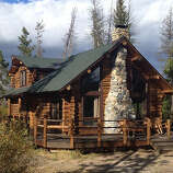 Redfish Lake Lodge, Stanley, ID  Why it's cozy: Classic log cabins with stone fireplaces, private decks with lake and creek views, and peace and quiet; none of the cabins have phones, TVs, or alarm clocks.  What's out the door: Swimming in the 5-mile-long namesake lake, hiking the 17.5-mile path that rings the lake, and lounging on its sandy beach.  Who will love it: Families.  11 one- to four-bedroom cabins; $$; open from Memorial Day weekend through early October;redfishlake.com  Read more: Top 10 vacation cabins & cottages