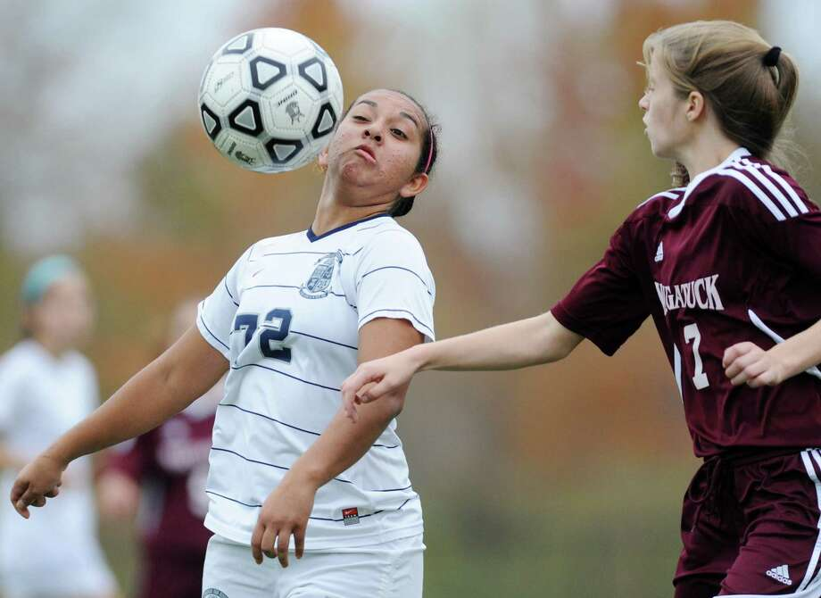 Immaculate's Natalia Diaz (72) controls the ball while defended by Naugatuck's Jessica Butler (7) in No. 2 Immaculate's 2-0 win against No. 15 Naugatuck in the second round of the CIAC Girls Soccer Class L State Tournament at Immaculate High School in Danbury, Conn. on Thursday, Nov. 6, 2013.  Diza scored both of Immaculate's goals in the game. Photo: Tyler Sizemore / The News-Times