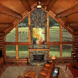 Triple Creek Ranch, Darby, MT  Why it's cozy: Wood-burning fireplaces, cedar walls, whirlpool tubs, king-sized log post beds, and pine forest views from the private decks.  What's out the door: The 600-acre ranch has horseback riding, hiking, snowshoeing, tennis courts, and a heated pool; there's also guided fly-fishing, white-water rafting, and even cattle driving on horseback in the nearby Bitterroot Mountains, Selway-Bitterroot Wilderness, and Salmon River.  Who will love it: Families with teens (only those 16 and older are allowed) looking for something for everyone.  17 one-bedroom, 5 two-bedroom, and 1 three-bedroom cabins; $$$$; triplecreekranch.com