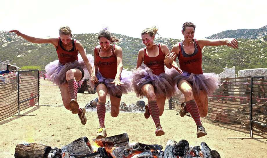 The Gladiator Rock 'n Run will attempt to break a record for the world's longest mud pit. The obstacle race starts at 8:30 a.m. Saturday at the National Shooting Complex. Photo: Courtesy Photo