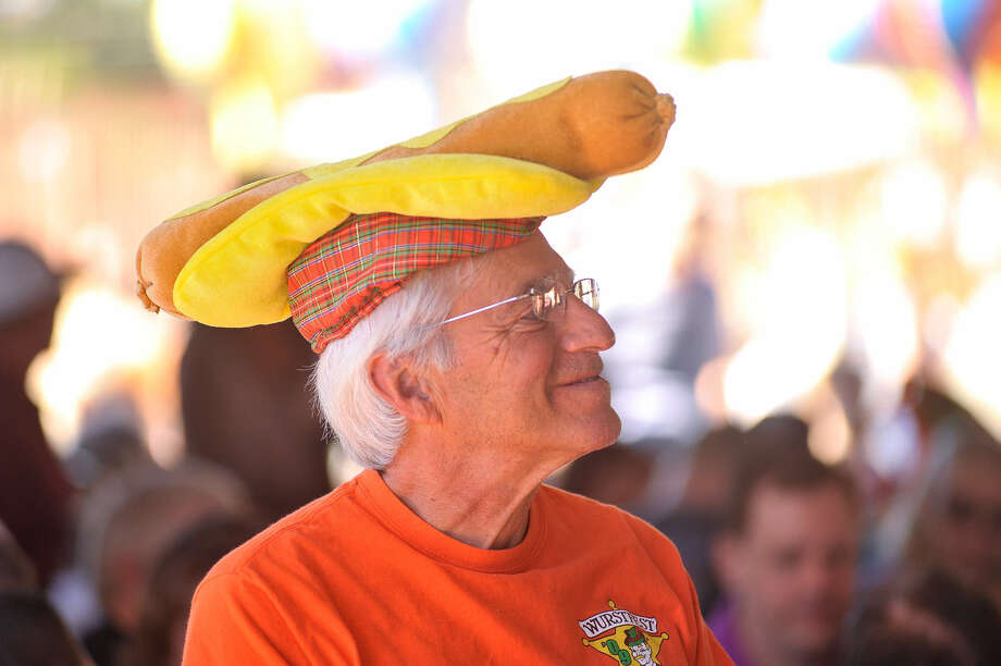 John Vuyosevich wears a sausage hat Sunday during Wurstfest in New Braunfels.