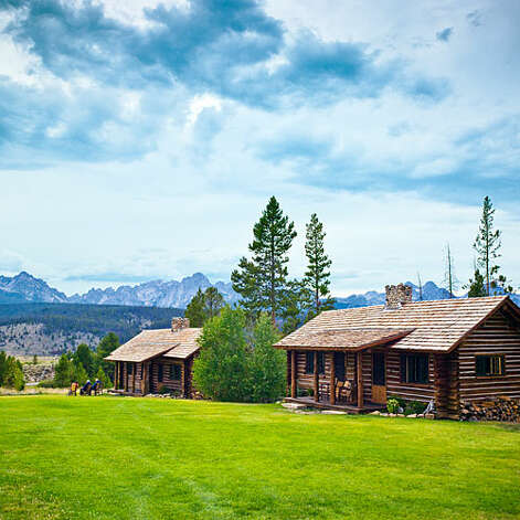 Idaho Rocky Mountain Ranch, Stanley, ID  Why it's cozy: Remodeled in 2009 with fir-wood floors, pine ceilings, walls of chinked lodge-pole pine, stone showers, and a big rock fireplace in every cabin. Also, no phones, TVs, or radios inside to let you truly appreciate the sounds of silence.  What's out the door: The 900-acre private backyard of the ranch grounds, surrounded by green meadows, with the jagged Sawtooth Mountains on the horizon. There are miles of hiking and mountain-biking trails and chances to fish and raft the Salmon River.  Who will love it: History buffs who want to experience the Old West come to life.  17 cabins (sleep 2 – 3); $$$; open from June – September; idahorocky.com    Photo: Thomas J. Story, Sunset.com