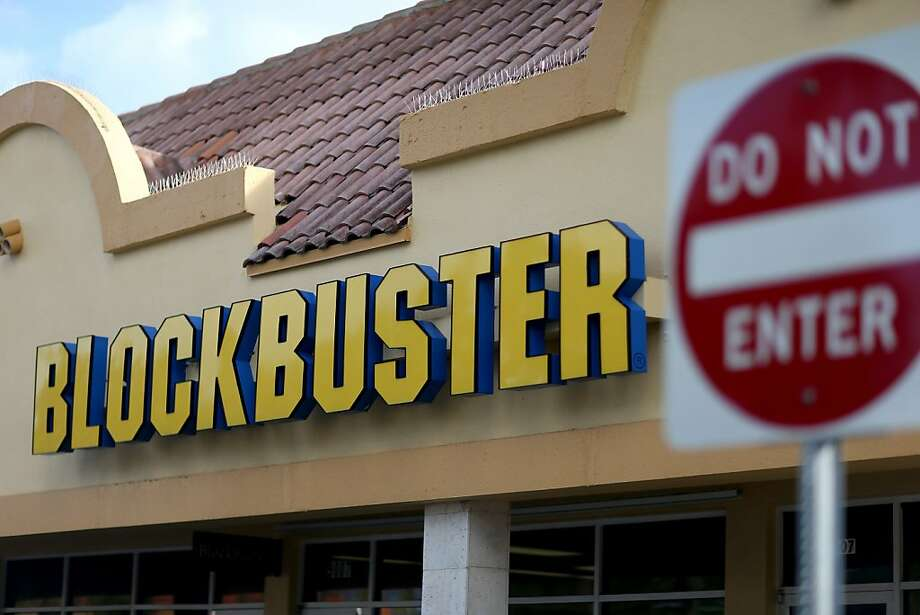 Dish Network, which acquired Blockbuster for $320 million in 2011, said its 300 remaining U.S. stores - like this one in Miami and three in the Bay Area - would be closed by early January. Photo: Joe Raedle, Getty Images