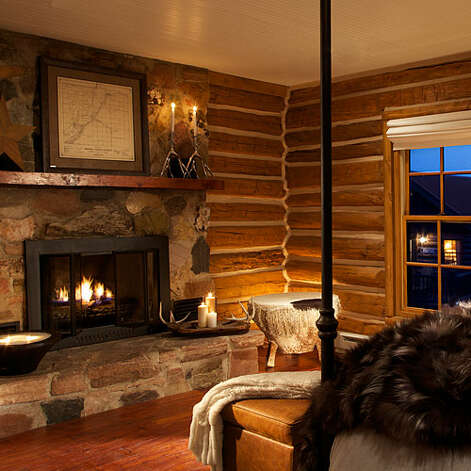 The Lodge & Spa at Brush Creek Ranch, Saratoga, WY Why it's cozy: Leather couches, potbelly stoves, 400-thread-count sheets, plush robes, and grocery-stocking services.  What's out the door: Fishing, horseback riding, hunting, yoga—you name it on the 15,000-acre ranch near the North Platte River Valley, with the million-acre Medicine Bow National Forest next door.  Who will love it: Newlyweds and families who decidedly don't want to rough it.  9 two- and three- bedroom cabins, plus cabin rooms and lodge rooms, $$$$; open daily from mid-May through mid-Oct and for long weekends year-round; brushcreekranch.com  Read more: 12 cozy winter lodges   Photo: Courtesy Of The Lodge & Spa At Brush Creek Ranch,  Saratoga,  WY, Sunset.com / © Dan Ham 2007