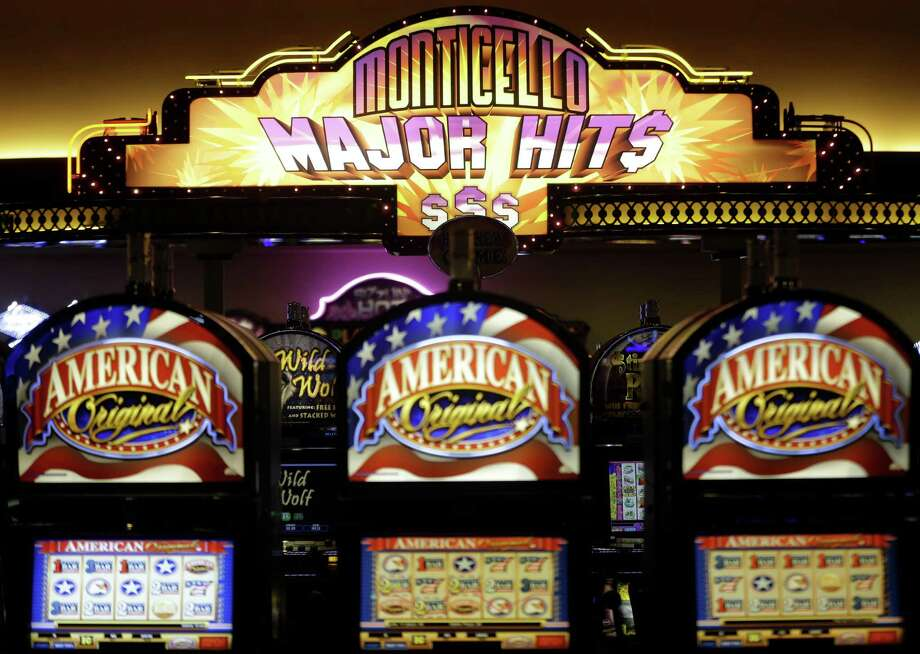 Video gambling machines are displayed at the Monticello Casino and Raceway in Monticello, N.Y., Wednesday, Nov. 6, 2013. New York voters approved an amendment to the state constitution on Tuesday, Nov. 5,  that authorizes seven Las Vegas-style casinos. Two will be in the Catskill-Hudson Valley region, where some potential sites include old Borscht Belt hotels.(AP Photo/Seth Wenig) ORG XMIT: NYSW111 Photo: Seth Wenig / AP