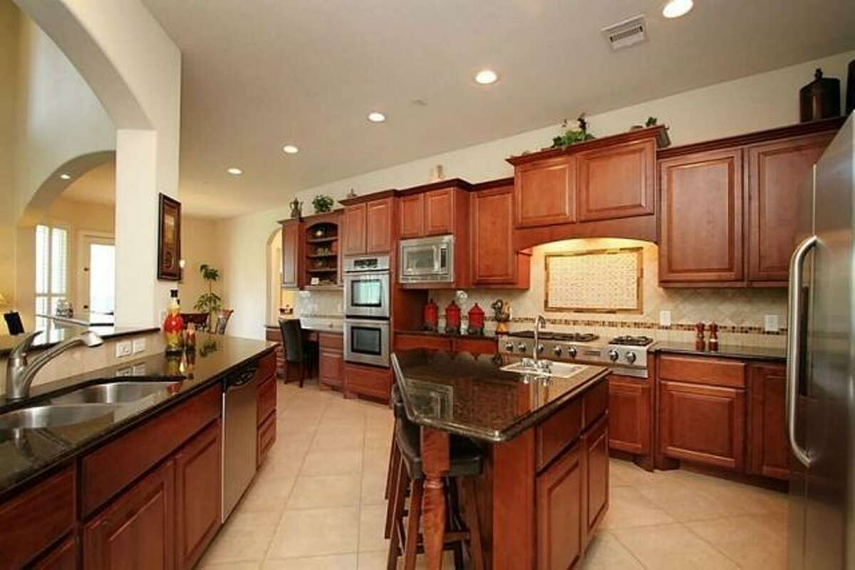 The home's stunning kitchen opens to the living and dining areas.