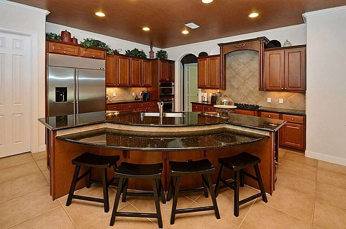 The kitchen boasts a granite counter with buffet.