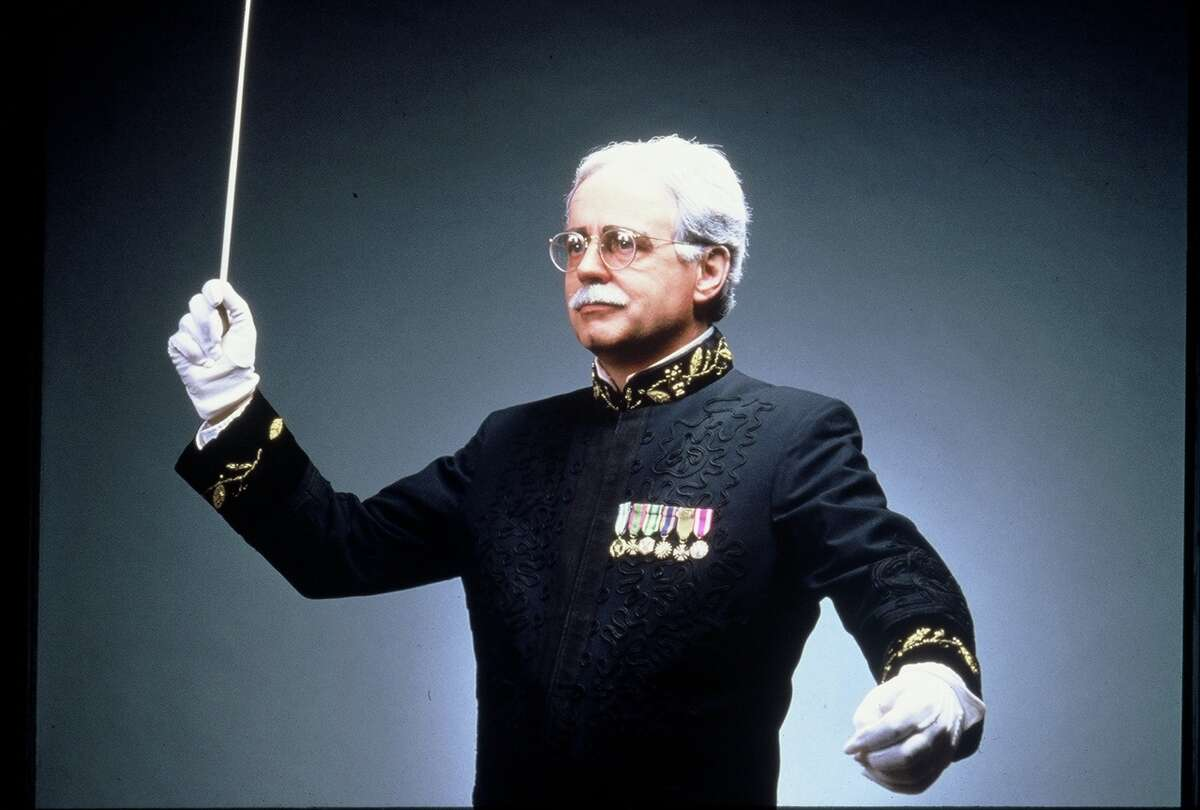 Conductor Keith Brion, costumed as John Philip Sousa, directs pops concerts patterned after those Sousa led with his own group.
