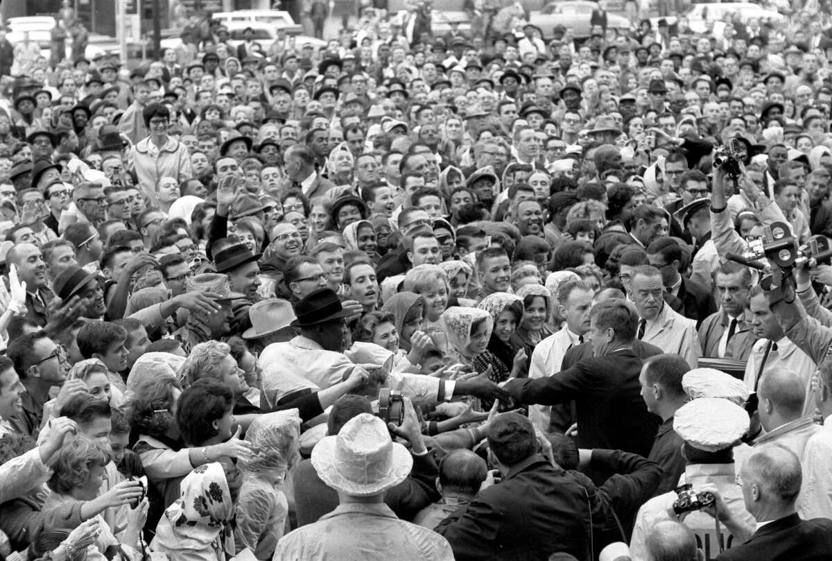 President Kennedy wades into a crowd of supporters after a speech outside the Hotel Texas in Fort Worth the morning of November 22, 1963.