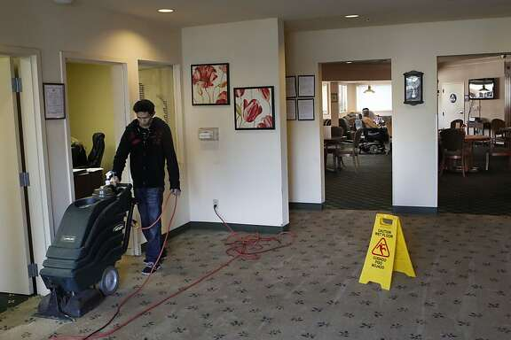 Carpets in the lobby are cleaned at the Sundial Senior Lodge in Modesto, Calif. on Wednesday Nov. 6, 2013. Improvements are underway since the facility was taken over by the State of California. Sundial Senior Lodge operated by the same owners as the Valley Springs Manor facility in Castro Valley, has been taken over by the State after conditions there were discovered to be below acceptable standards.