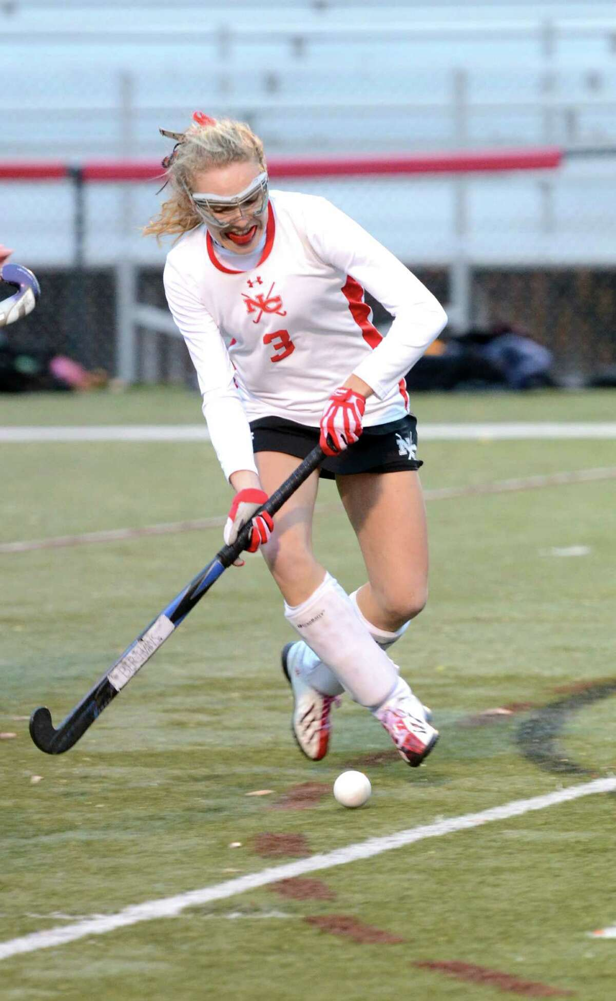 New Canaan's Maureen Schott (3) controls the ball during the field hockey Class L first round game against South Windsor at Dunning Stadium at New Canaan High School on Wednesday, Nov. 6, 2013.