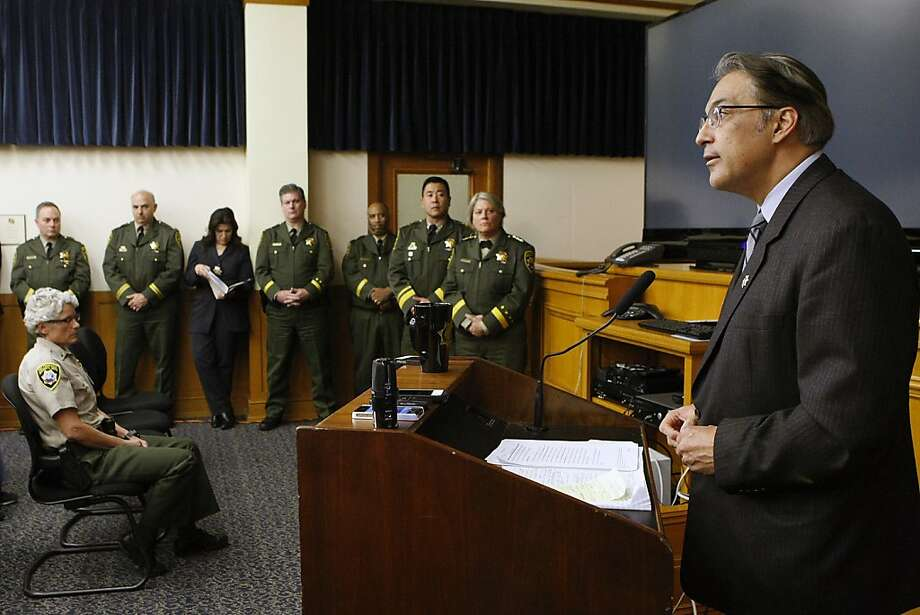 Staff from the Sheriff's Department looks on as Sheriff Ross Mirkarimi, right, holds a press conference at City Hall in San Francisco on Wednesday, November 6, 2013, to discuss preliminary findings on the case of Lynne Spalding. Photo: Michael Short, The Chronicle