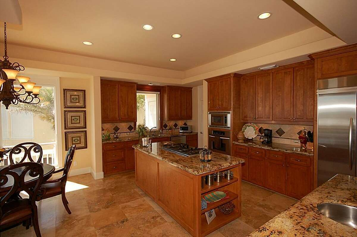 The home's kitchen includes two granite islands.