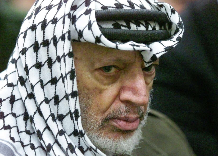 FILE - In this May 31, 2002 file photo, Palestinian leader Yasser Arafat pauses during the weekly Muslim Friday prayers in his headquarters in the West Bank city of Ramallah. Al-Jazeera is reporting that a team of Swiss scientists has found moderate evidence that longtime Palestinian leader Arafat died of poisoning. The Arab satellite channel published a copy of what it said was the scientists' report on its website on Wednesday, Nov. 6, 2013.(AP Photo/Lefteris Pitarakis, File) Photo: Lefteris Pitarakis, STF / AP