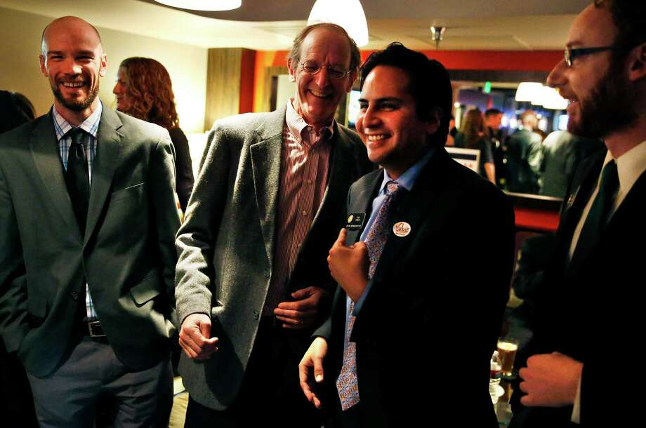 Brian Vicente, chairman of the Yes on Prop. AA campaign, left, and, left to right, campaign manager Rick Ridder, state Rep. Dan Pabon, and state Rep Jonathan Singer celebrate a victory during an election party for those in favor of Proposition AA, to impose specific taxes on recreational marijuana use, at a hotel bar in Denver, Tuesday, Nov. 5, 2013. Voters in Colorado went to the polls Tuesday to decide on how much tax to levy on the state's soon-to-be-legal recreational marijuana sales. (AP Photo/Brennan Linsley) Photo: Brennan Linsley, STF / AP